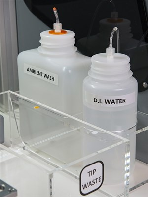 Room for wash and D.I. water bottles on the deck of the instrument